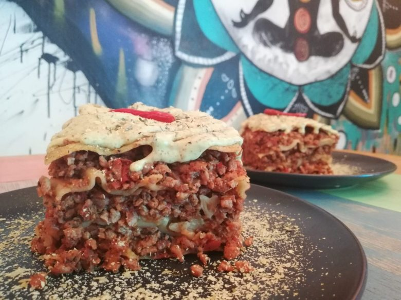 Vegan lasagna in a punk rock setting at Veganga Russian vegan restaurant