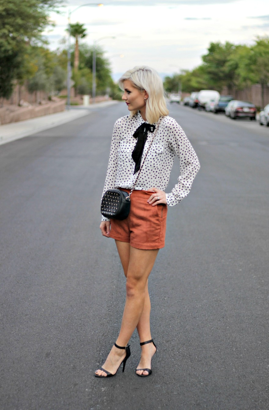 suede-shorts-polka-dot-shirt-bow-blouse-studded-purse-lindsey-simon-the-nomis-niche-las-vegas-fashion-blogger-beauty-blogger-1
