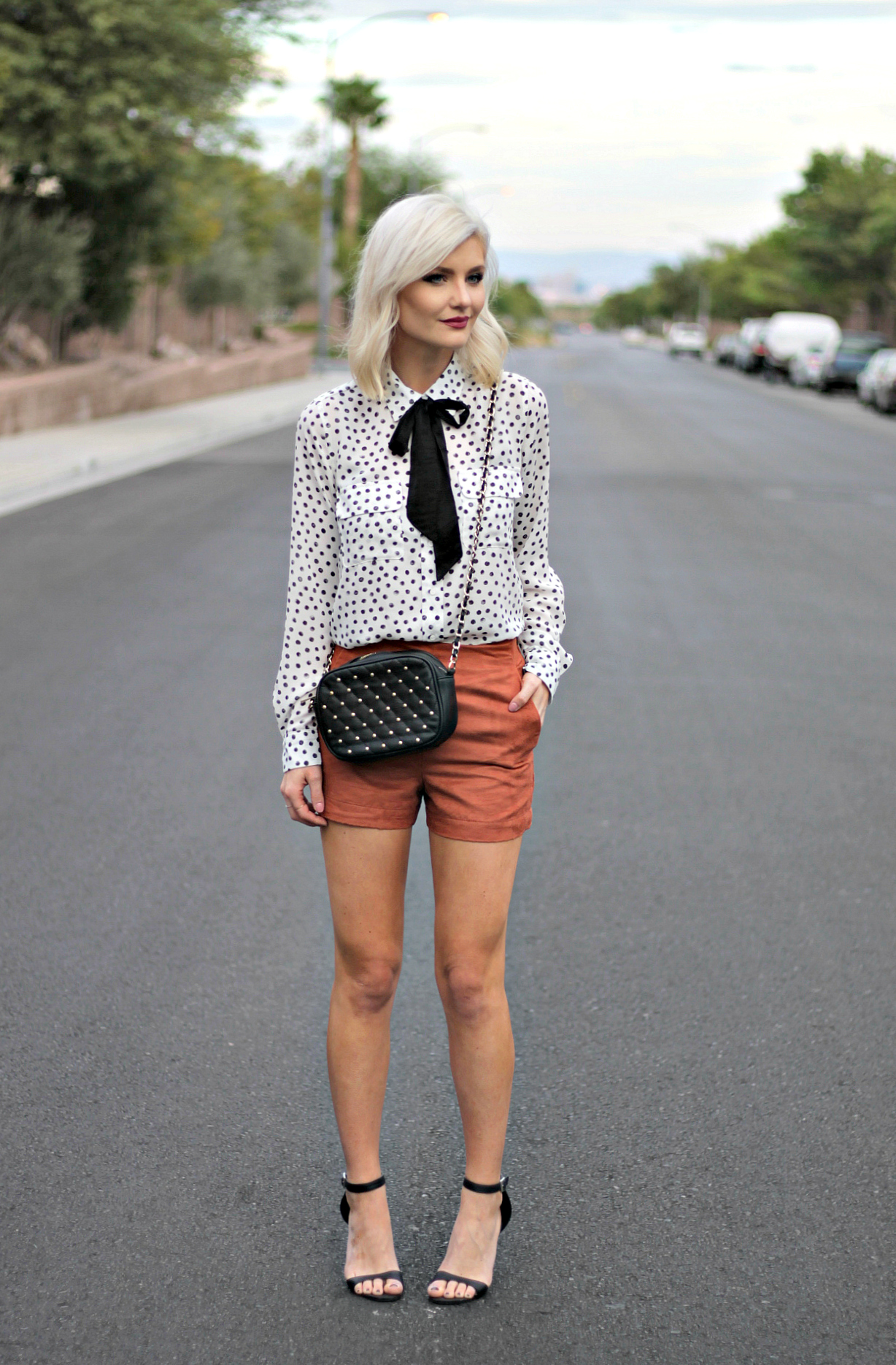 0ecce6814f83 suede-shorts-polka-dot-shirt-bow-blouse-studded-purse-lindsey-simon-the-nomis-niche-las-vegas-fashion-blogger-beauty-blogger-2  - The Nomis Niche