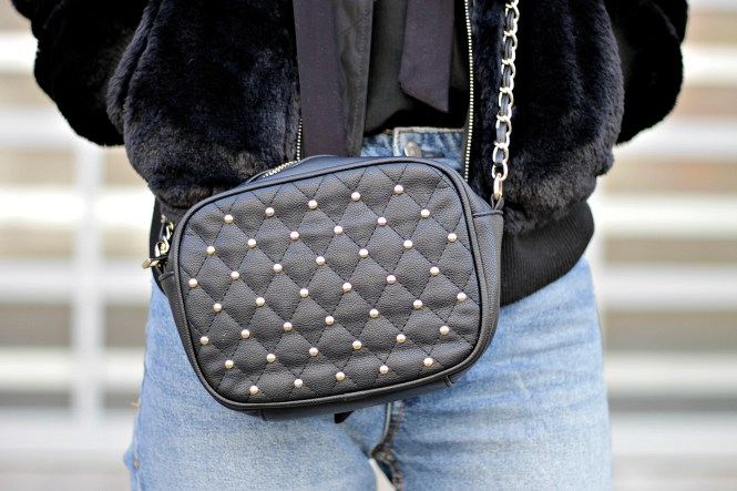 Street style - faux fur bomber jacket and studded chain strap cross body bag