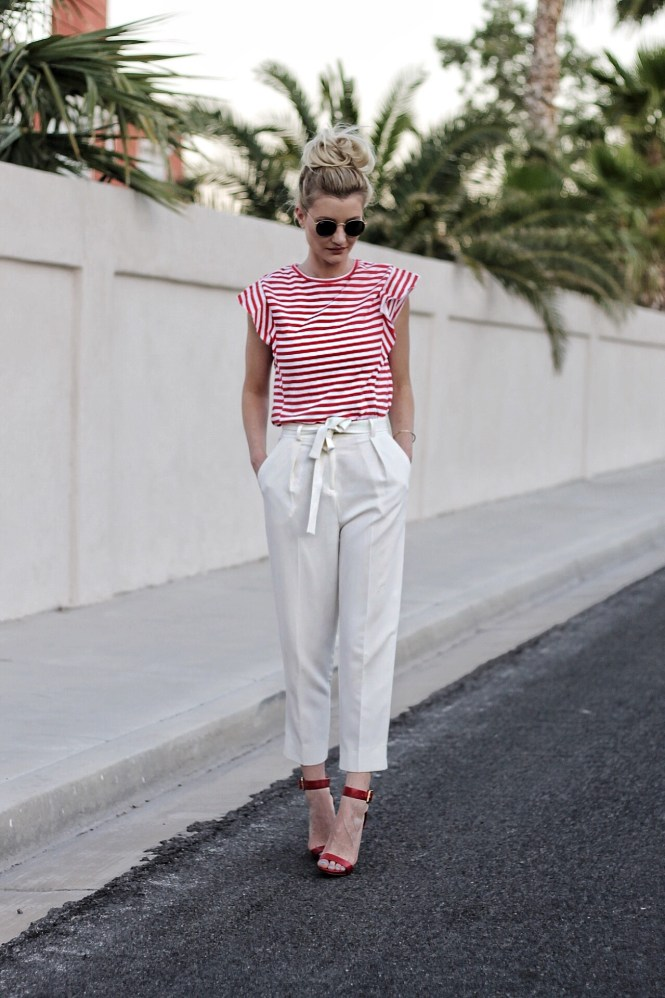 summer outfit inspo, white pants, white trousers, ruffle top, striped top, how to wear, paperbag waist pants, tie waist pants, red heels, topknot, fashion blogger, las vegas, 4th of july, memorial day,