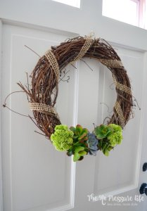 DIY succulent wreath tutorial. Make this simple succulent wreath is just 5 minutes with this tutorial from The No Pressure Life.