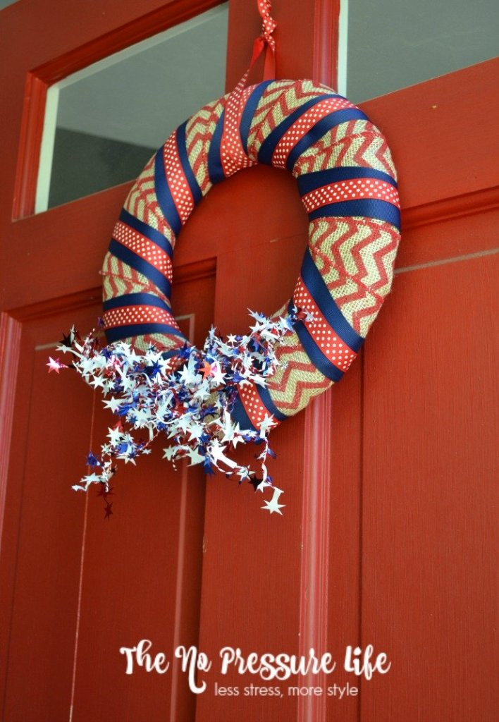This easy DIY patriotic wreath is a simple 4th of July craft. Make it in 15 minutes or less! Get the step-by-step tutorial at www.thenopressurelife.com.