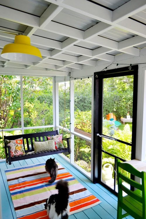 Please pin from original source - colorful small porch with painted furniture via Red Bird Blue