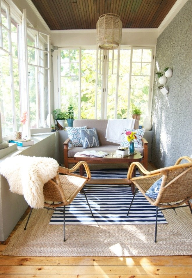 Please pin from the original source. Small porch with layered rugs via Curbly