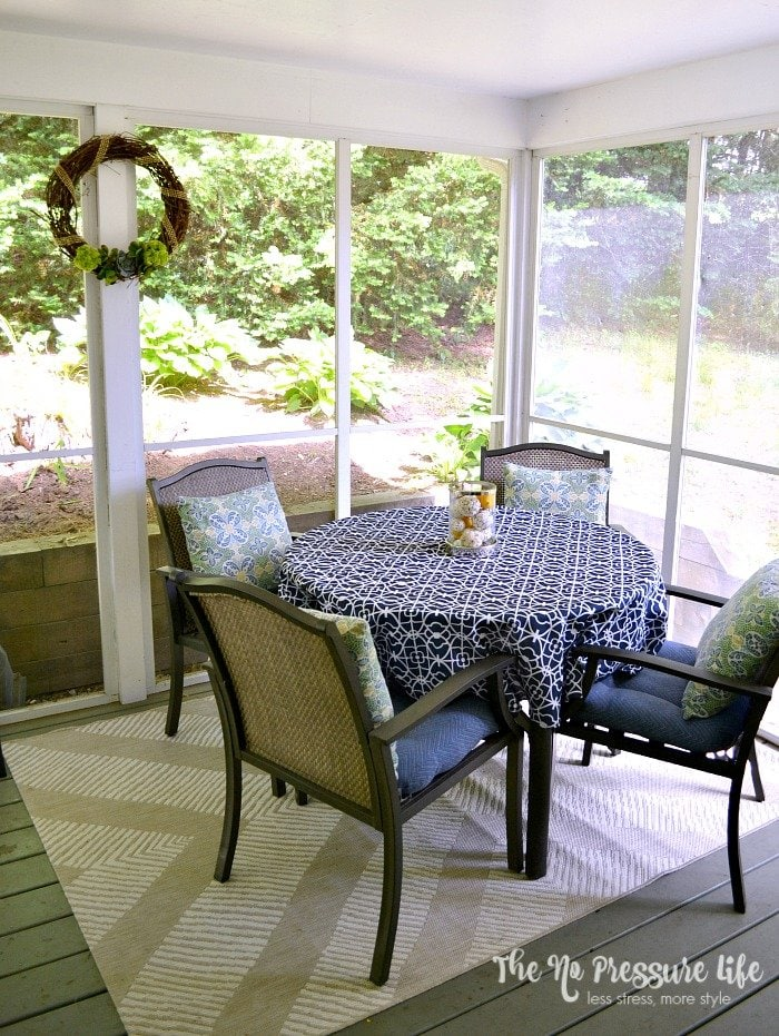 Decorating a screened in porch our budget makeover Screened in porch decor