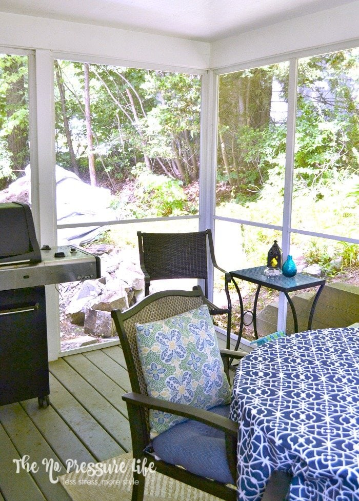 Small Porch Decorating: A small screened-in porch gets a blue and white update for summer.