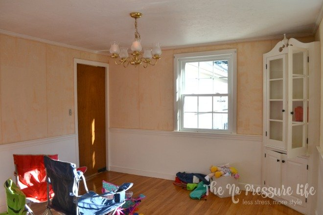 Dining room with partially stripped wallpaper