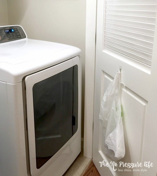 laundry room organization tip on a budget - easy trash and lint container