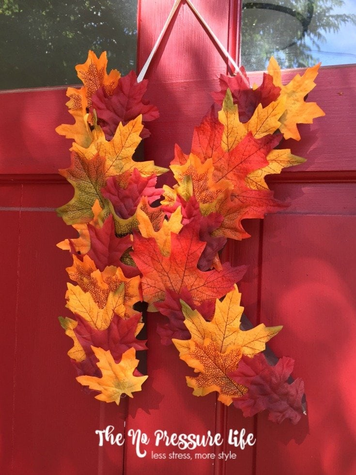 Make this pretty fall door decor in less than 20 minutes! A DIY fall monogram wreath is an easy way to decorate your front door. Get the tutorial at The No Pressure Life.