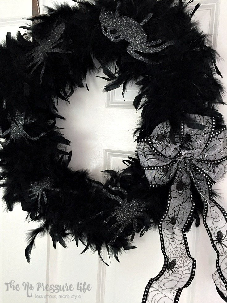 Learn how to make this easy feather Halloween wreath and other last-minute Halloween crafts at The No Pressure Life.