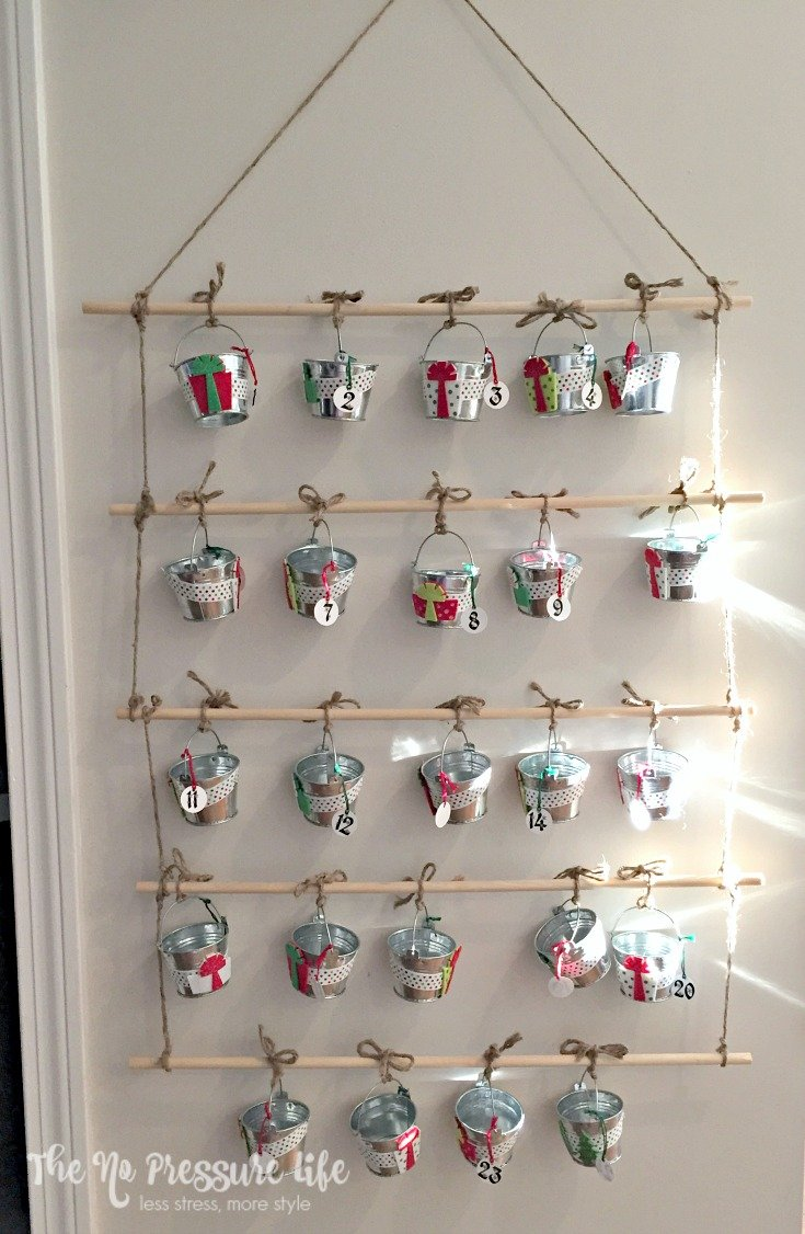 This unique DIY advent calendar is simple and inexpensive to make! This Christmas craft is cute, and kids love finding treats in the advent calendar. | The No Pressure Life
