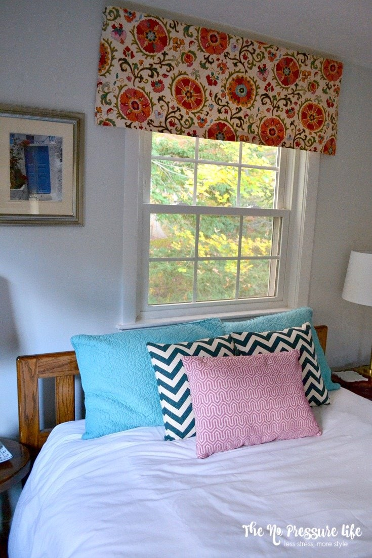 Bohemian Guest Room makeover with suzani window treatments.