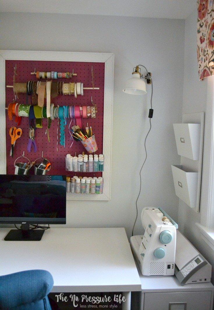 Simple craft room organization with a DIY peg board.