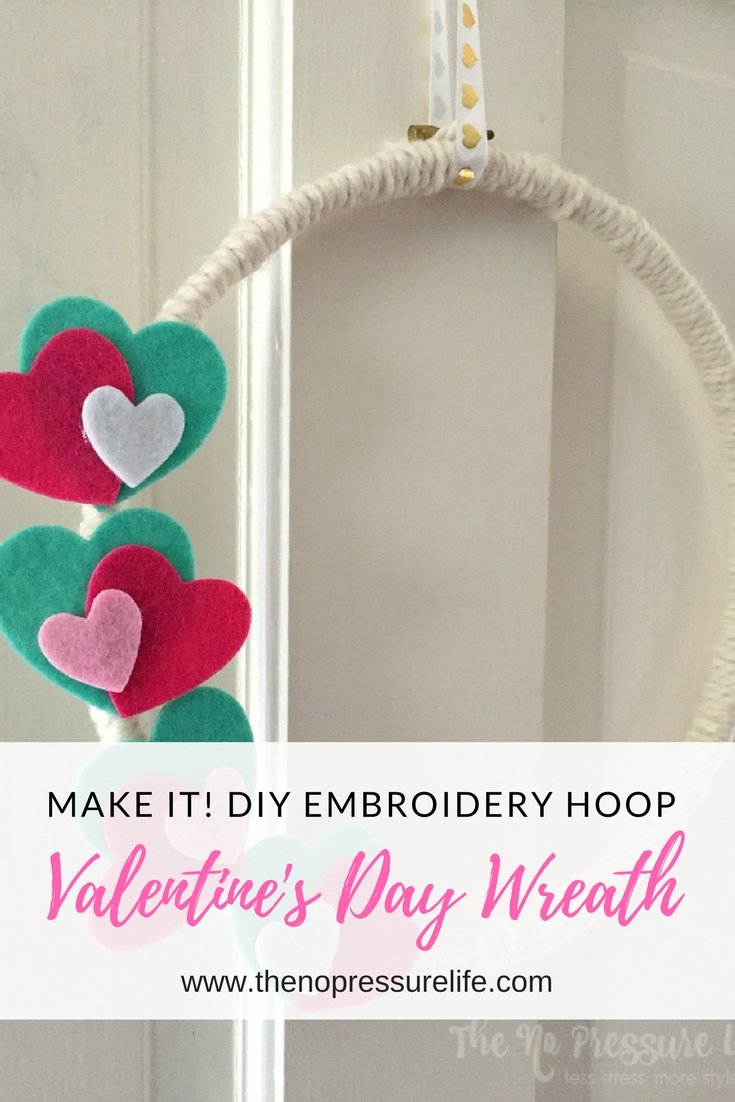 This embroidery hoop and yarn Valentine's Day wreath is an easy craft project for Valentine's Day! Learn how to make it at The No Pressure Life.