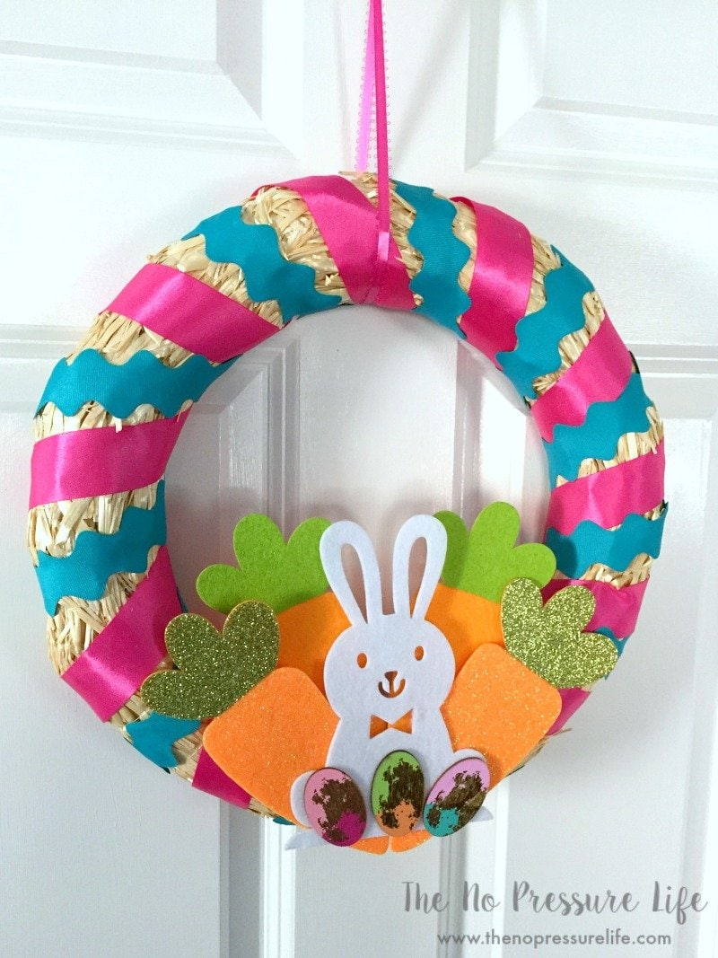 cute and easy DIY Easter wreath for front door with pink and blue ribbon