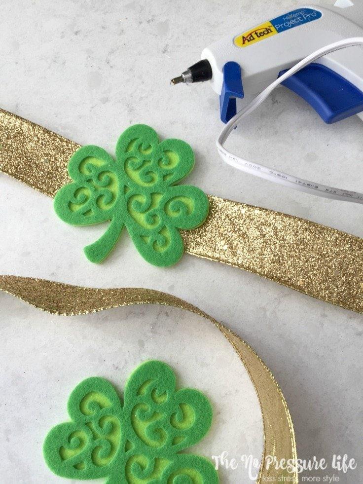 Felt shamrocks and gold ribbon with a glue gun for St. Patrick's Day mantel decor
