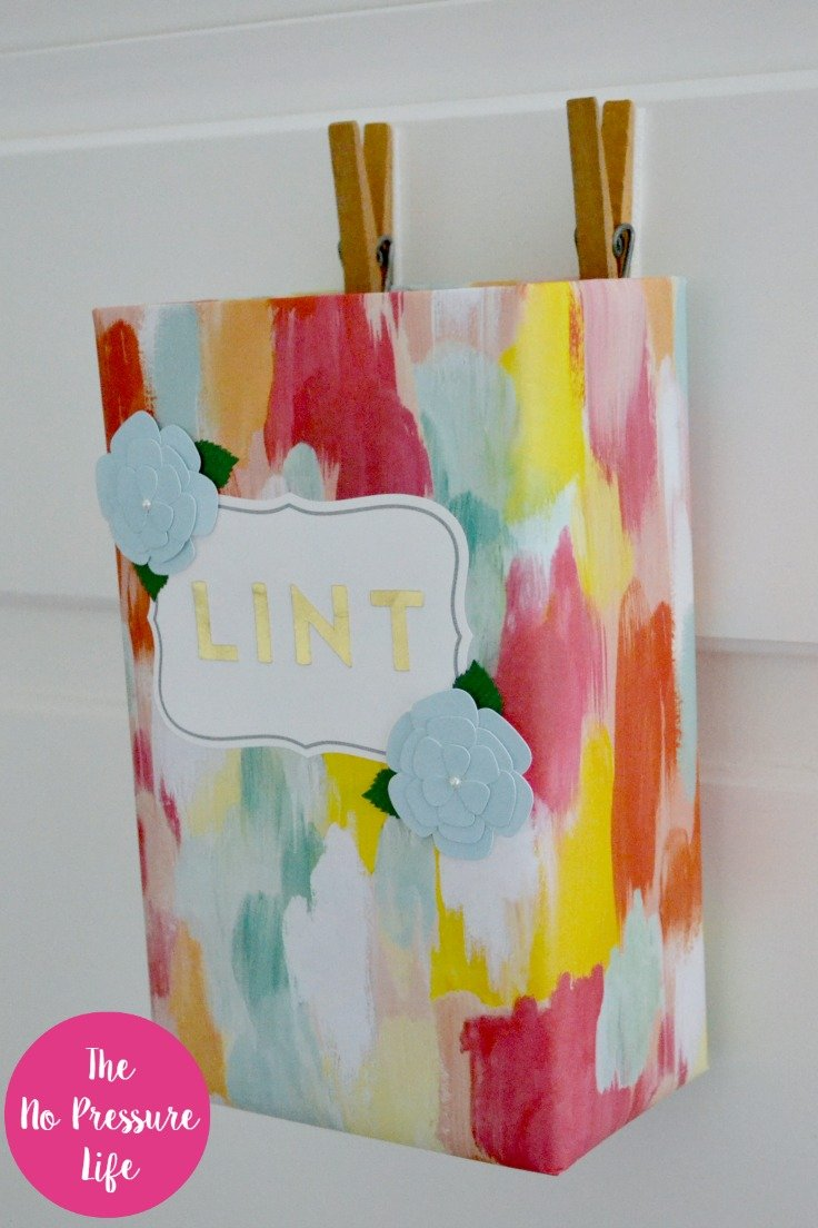 This is such a lovely laundry room lint bin! Wait til you see what it's made from. This DIY lint bin is both practical and a simple laundry room craft. Read the easy tutorial PLUS get a free laundry room art print. via @nopressurelife