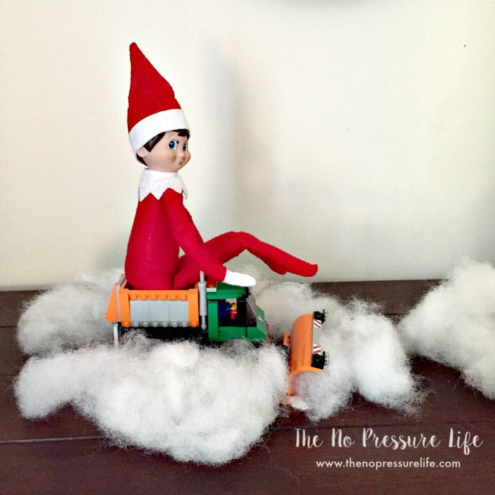 Easy elf on the shelf idea: riding a toy snowplow