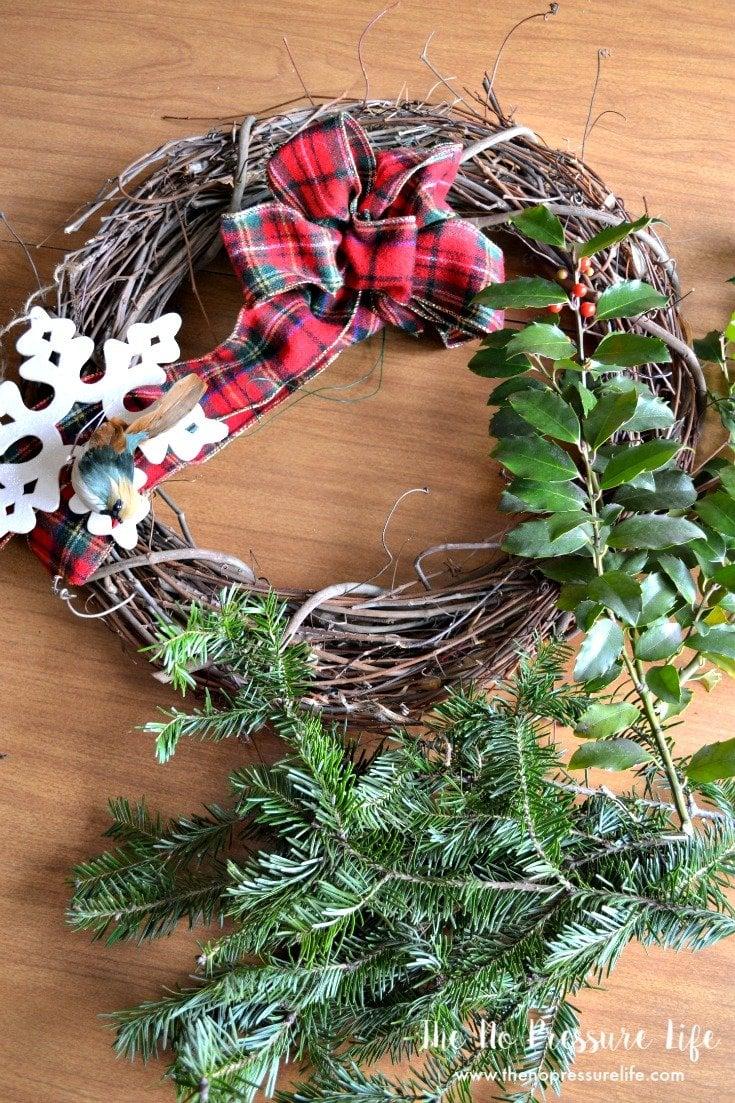 How to make a DIY grapevine Christmas wreath.