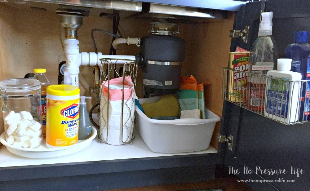 How to organize cleaning supplies under the kitchen sink with a lazy susan and dollar store supplies to fit around awkward plumbing