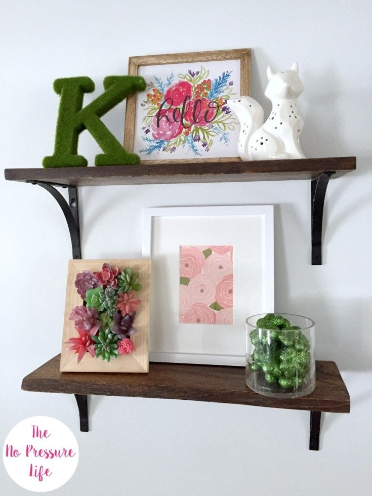 spring shelf decor with framed faux succulent art