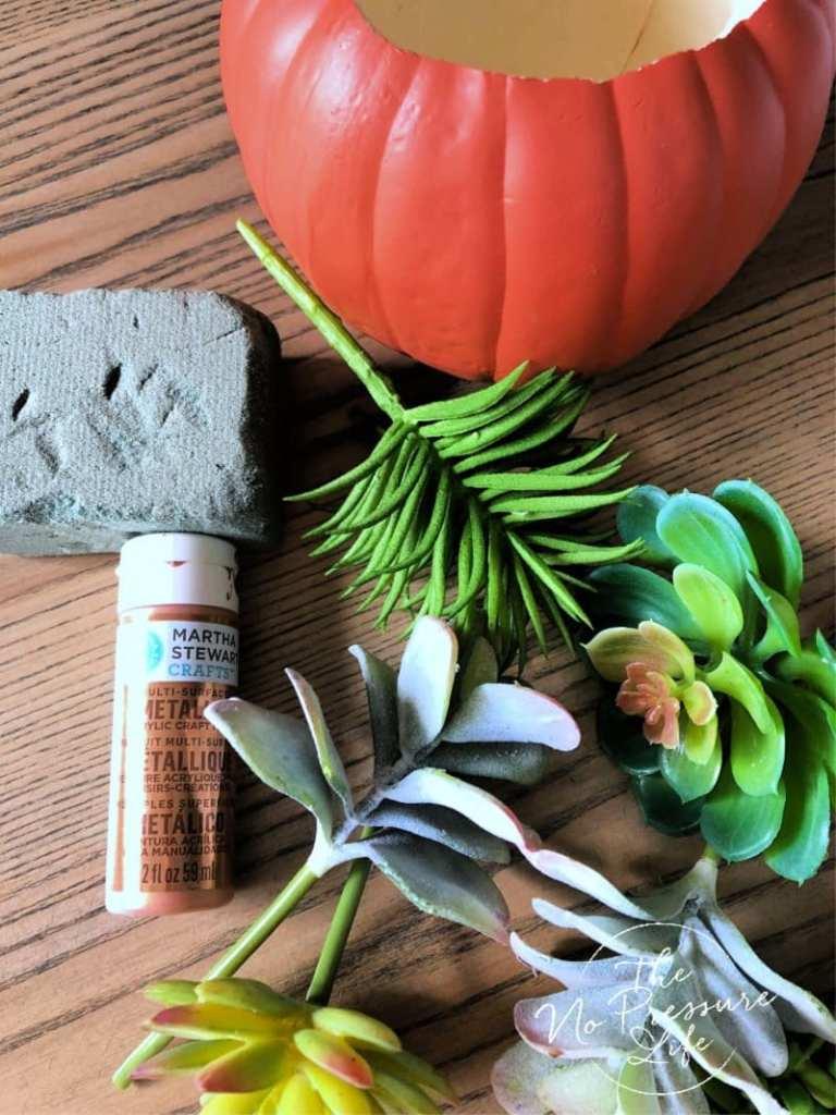 Supplies to make a DIY faux succulent pumpkin arrangement