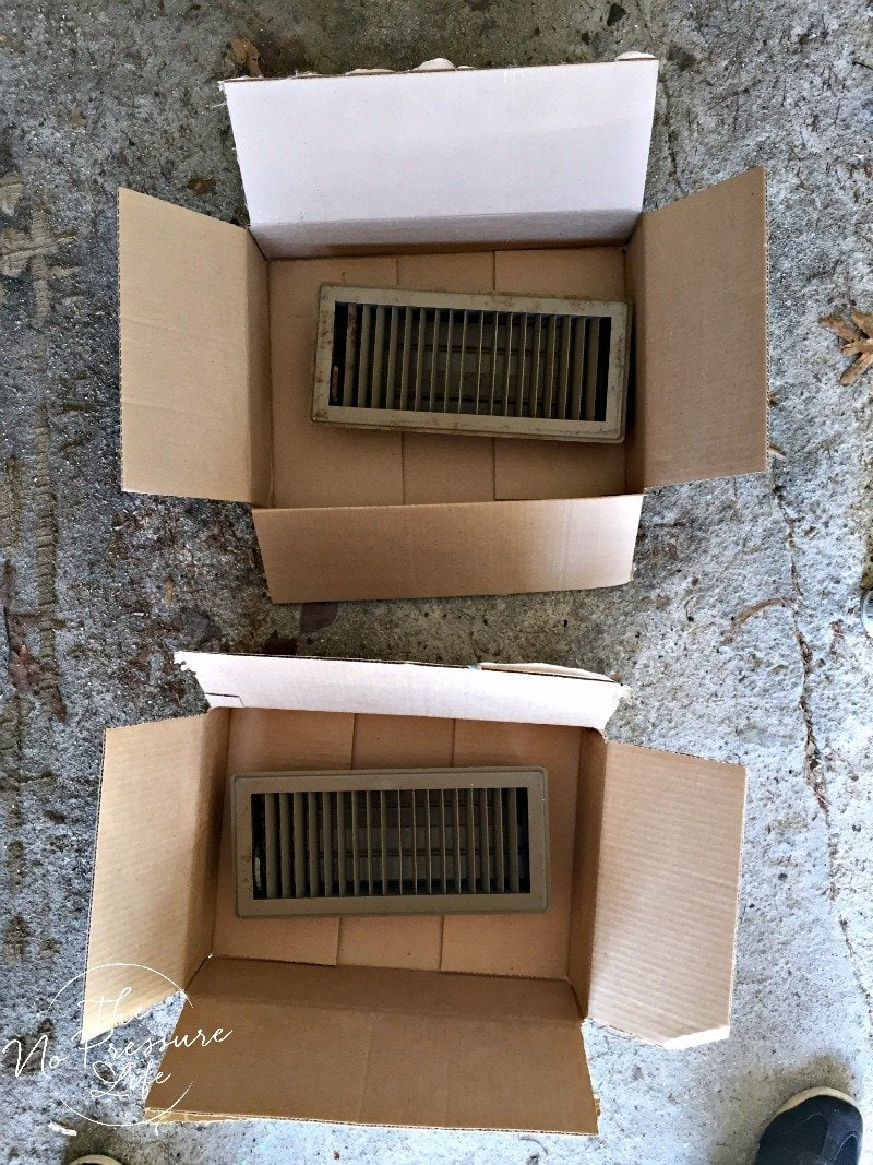 How to spray paint metal floor vent covers - rusty vent covers in boxes ready to spray paint