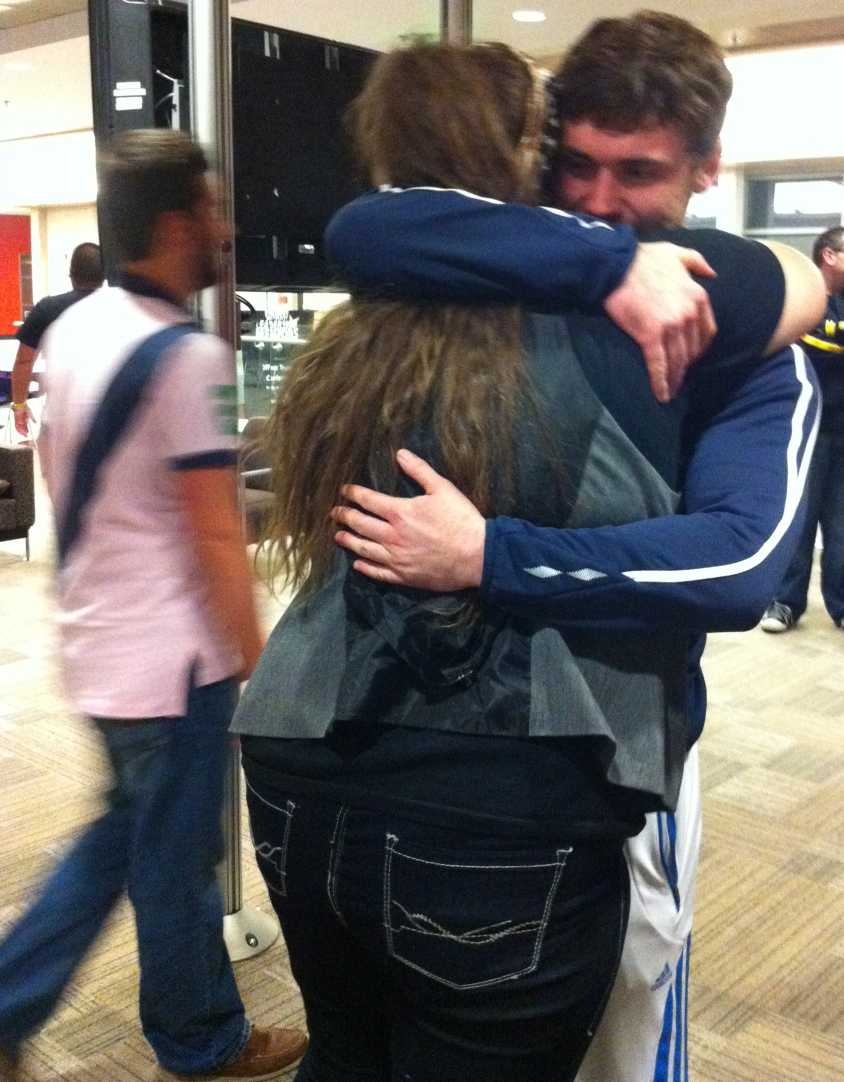 Erik Pederson (right) embraces Chanell Karr after being announced the 2012-13 Student Government Association president.