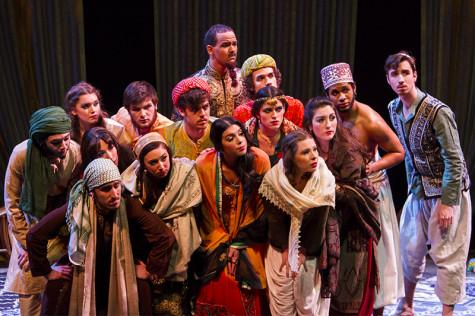 The cast of Arabian Nights look on.