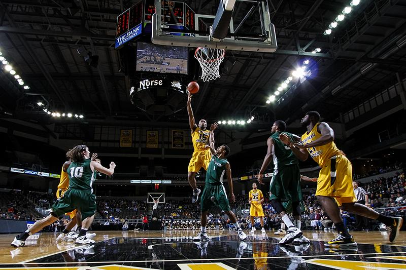 NKU forward Daniel Camps (15) shoots a layup during the first half of NKU's win over Stetson. NKU won 96-58 against Stetson on Feb. 27, 2014 at The Bank of Kentucky Center.