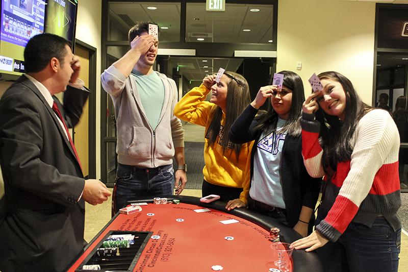 Students+participate+in+a+card+game+at+Casino+Night%2C+part+of+APB%27s+Student+Union+Festival.+