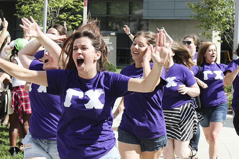 Gamma Chi's Arnela Zekic and Elizabeth Ruwe take part in the bid day festivities. The event lets students meet their new 'families' as well as promote sisterhood.