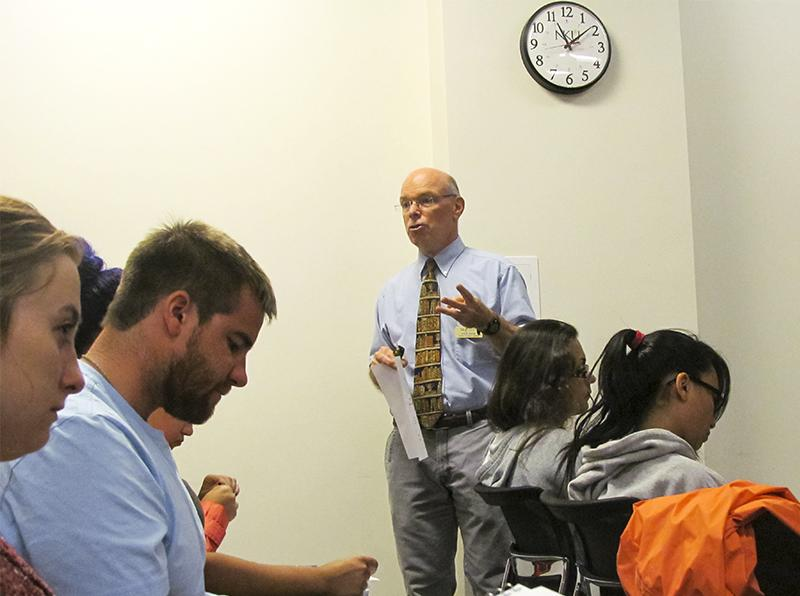 Paul Ellis, director of the Learning Assistance Program, gives freshmen tips for collaborative studying.