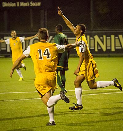 NKU player Kobie Qualah (right) celebrates after scoring his second goal of the night in NKU's come from behind overtime win on Tuesday night. The Norse beat Wright State 4-3 in overtime on September 23, 2014 at NKU Soccer Stadium.