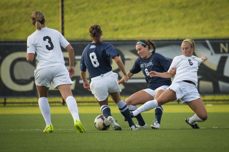 NKU midfielder Jaclyn Elmore goes for the ball in NKU's 2-1 overtime loss Wednesday night. NKU lost in overtime 2-1 against Butler University at NKU Soccer Stadium on Wednesday, Sept. 17, 2014.