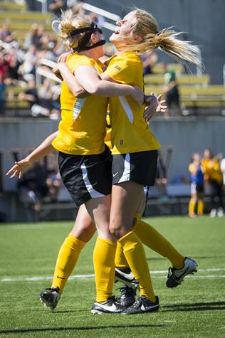 NKU's Sami Rutowski (left) and Aubrey Muench (right) celebrate after Sami's game winning goal in overtime against Robert Morris. NKU beat Robert Morris 2-1 in overtime at NKU Soccer Stadium on Sept. 14, 2014.