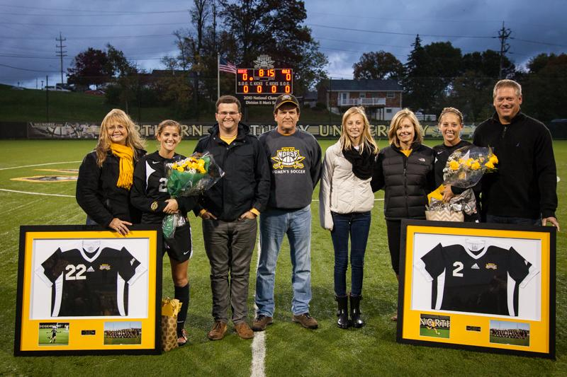 NKU celebrated senior day for it's two seniors, CG Bryant (left) and Abbey Scherer (right) before their 1-0 win against Kennesaw State. NKU defeated Kennesaw State 1-0 off a header by Jessica Frey in the second half at NKU Soccer Stadium on Oct. 18, 2014.