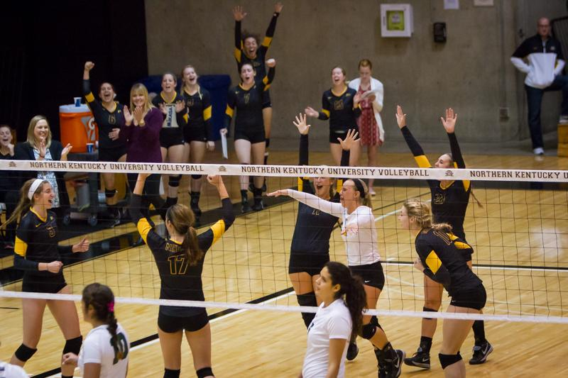 NKU+volleyball+celebrates+their+win+against+Jacksonville.+NKU+defeated+Jacksonville+3-0+on+Friday%2C+Oct.+11%2C+2014+at+Regents+Hall.