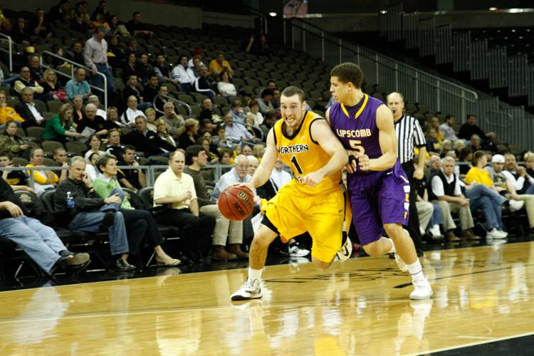 Ethan+Faulkner+drives+to+the+basket+during+the+2012-2013+season+against+Lipscomb+University.+Faulkner+is+now+an+assistant+coach+for+the+Norse.