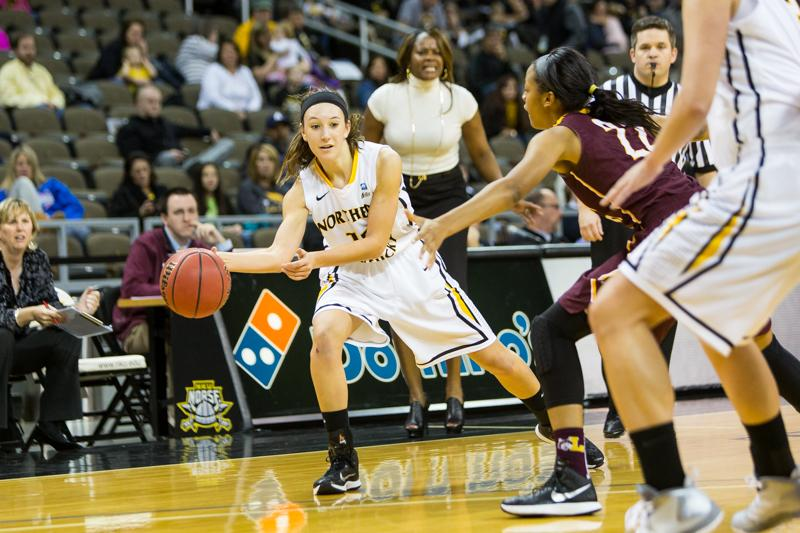 NKU+junior+Christine+Roush+passes+the+ball+to+a+teammate+during+NKU%27s+38-45+loss+to+Loyola+%28Chicago%29.+NKU+lost+to+Loyola+%28Chicago%29+35-45+at+The+Bank+of+Kentucky+Center+on+Nov.+22%2C+2014.