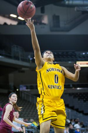 NKU's Shar'Rae Davis goes up for a layup during the second half of NKU's win over IUPUI. NKU defeated IUPUI 57-43 at the Bank of Kentucky Center on Tuesday, Dec. 30, 2014.