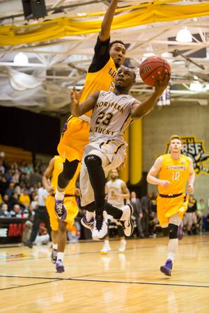 NKU guard Todd Johnson (23) goes up to shoot the layup during NKU's first A-Sun conference tournament game hosted at Regents Hall. NKU lost to Lipscomb in NKU's first A-Sun conference tournament 76-73 in Regents Hall on Tuesday, Mar. 3, 2015.