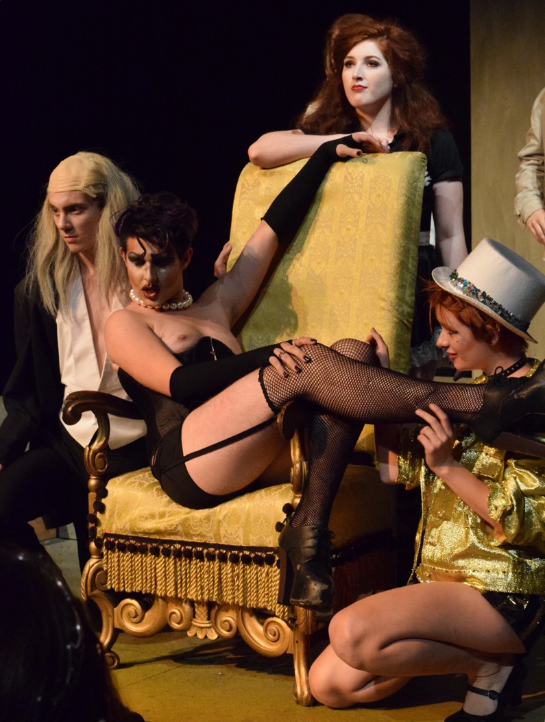 "Frank-N-Furter's opening song, ""Sweet Transvestite"" comes to a close. Frank-N-Furter, who sits in the throne and is surrounded by his servants, is portrayed by Josh Newman in NKU's ""The Rocky Horror Picture Show"" shadowcast production."