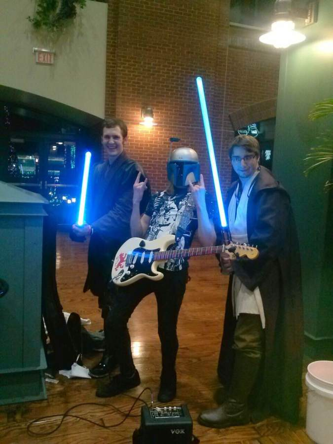 Jared+Koshiol+hangs+out+with+other+Star+Wars+fans.+Koshiol+is+wearing+a+Jango+Fett+helmet.