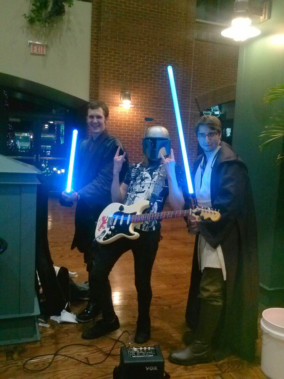 Jared Koshiol hangs out with other Star Wars fans. Koshiol is wearing a Jango Fett helmet.