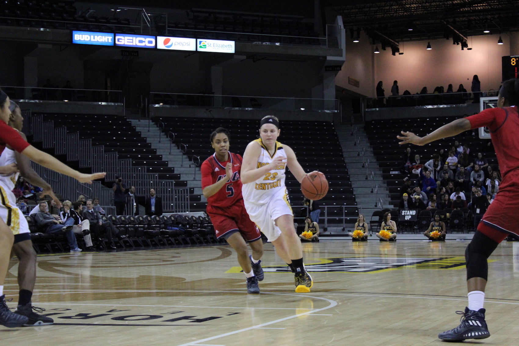 NKU's Kasey Uetrecht drives to the basket on Thursday against UIC.
