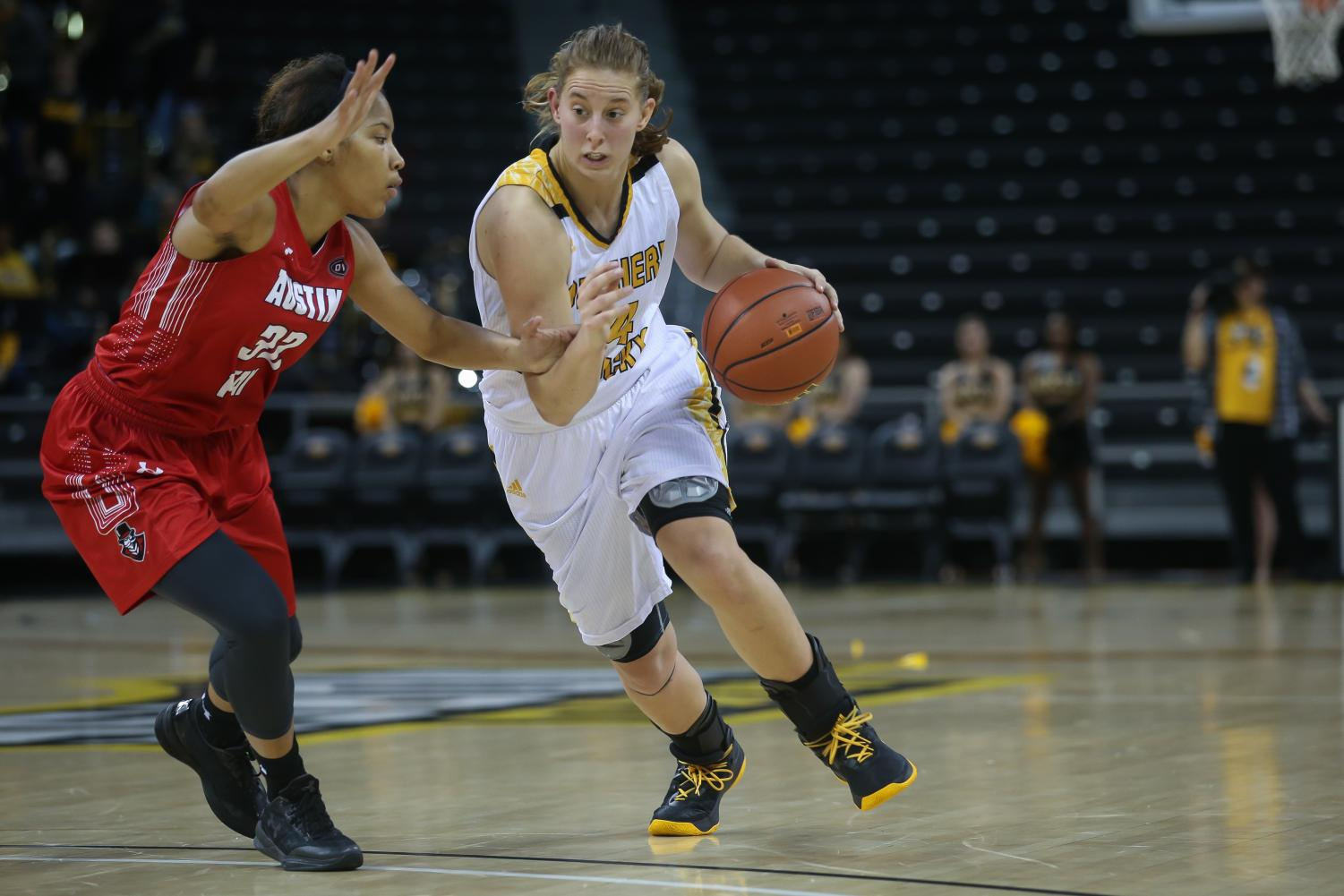 Molly Glick (24) drives toward the basket in the game against  Austin Peay.