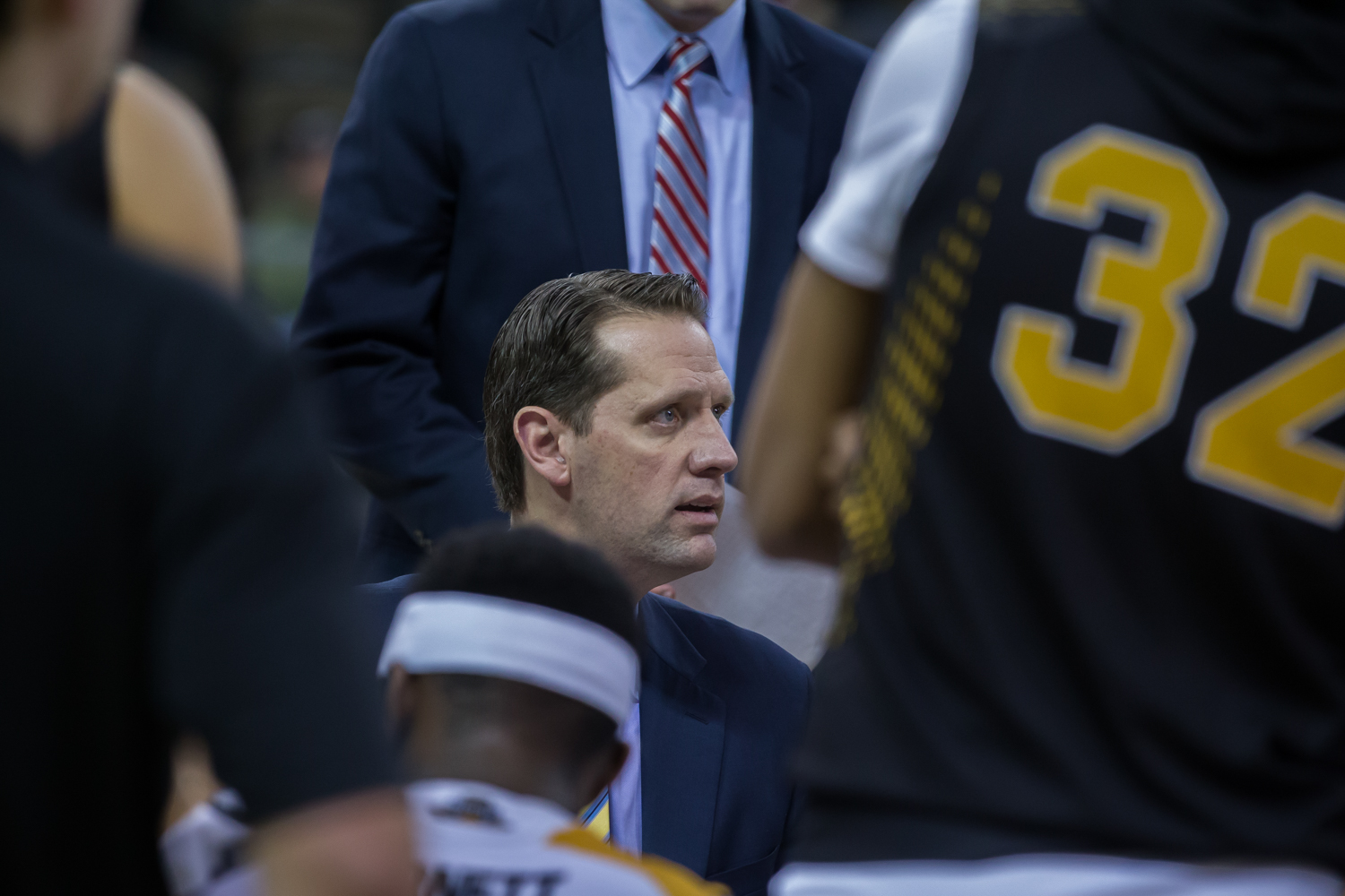 Head Coach John Brannen talks to his team during a timeout in the game against Cleveland State.
