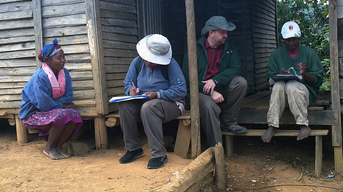 Professor Douglas Hume with his research assistants in Mahatsara, Madagascar, in summer 2012; they were conducting an ethnographic interview with an informant (not pictured).